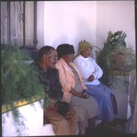 Antjie Kassie, Katriena Esau and an unidentified member of the San community rest outside the South African San Institute (SASI) offices in Upington, South Africa.