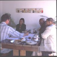 Nigel Crawhall meets with Magdalena Kassie, Andries Olyn and an unidentified member of the San community at the South African San Institute (SASI) office in Upington, South Africa. Magdalena Kassie played a pivotal role in promoting the language to San youth and the wider public. She passed away in 2010.Andries Olyn was a fluent N|uu speaker from Raaswater. He was a member of the Council of Elders and the last remaining N|uu speaker. He died in 2013