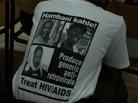 T-shirt with slogans-  Hambani kahle! Produce generic antiretrovirals Treat HIV/AIDS