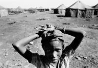 Child in tented settlement