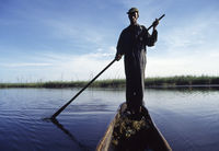 Fishing from a dugout canoe