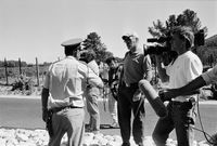 Policeman instructing media, Cape Town