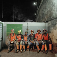 Six miners sitting in rest area, Bultfontein Mine, Kimberley, South Africa