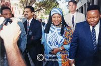 Winnie Mandela walks with friends, Cape Town