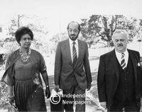 Winnie Mandela with the family's lawyers, Cape Town