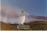 Helicopter showers fire with water, Cape Town