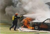 Fireman puts out burning cars, Cape Town