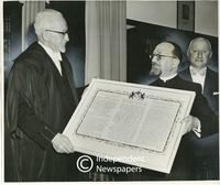 "Rabbi Israel Abrahams hands ""Prayer for the Republic of South Africa"" to Mr Klopper, Cape Town"