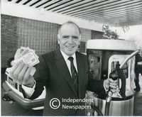 Raymond Ackerman at a petrol station promoting Pick 'n Pay coupons, Cape Town