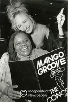 Two female singers from the band Mango Groove, show programme that is for sale , Cape Town