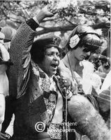 Winnie Mandela speaks into a microphone at a protest, Cape Town