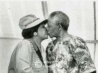 Winnie and Nelson Mandela share a kiss, Cape Town
