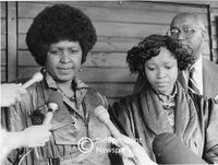 Winnie Mandela and her daughter talk to the media, Cape Town