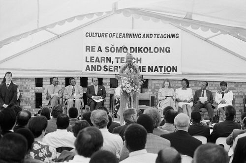 Nelson Mandela speaks at the opening of the Culture of Learning and Teaching Campaign, P.T. Semilane School, Soweto, 1997. Photo by William Matlala