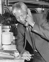 Nelson Mandela on the telephone in a kitchen, Cape Town