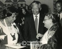 Nelson and Winnie Mandela share a joke with a supporter, Cape Town