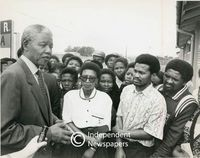 Nelson Mandela talks to teachers and pupils at a school named in his honour, Cape Town