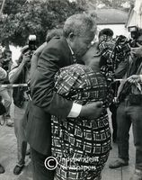Nelson Mandela kisses a supporter on the cheek, Cape Town