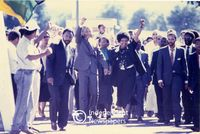 Nelson and Winnie Mandela share their jubilation with supporters after his release, Cape Town