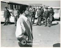 Dr. Allan Boesak walks past police officers, Cape Town