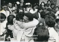 Allan Boesak hugs a member of his congregation, Cape Town