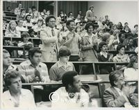 Allan Boesak applauds at a lecture, Cape Town