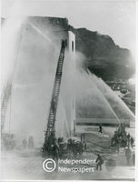 Firemen putting out a fire, Cape Town