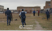 Policemen chase gangsters, Mannenberg, Cape Town