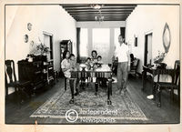 Family sitting in living room of their rented house in the Malay Quarter, Cape Town