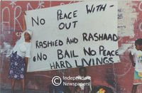 Banner raised in protest over the success of the peace initiative in Manenberg, Cape Town