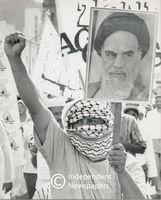 Man holds placard of Ayatollah Khomeini, Cape Town