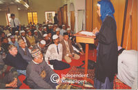 Muslim woman address congregation in Mosque, Cape Town