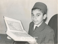 Muslim boy holds Koran, Cape Town