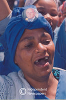Woman with National Party bade pinned to headscarf, Cape Town