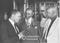 Three African representatives talk to one another , Cape Town