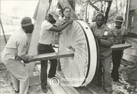 Grindstone for Josephine Mill being rolled into place, Cape Town