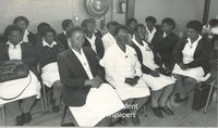 A group of nurses sit and wait, Cape Town