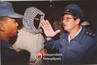 Policeman speaks to Pagad member, Cape Town
