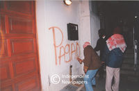 Pagad member spray paints on wall, Cape Town