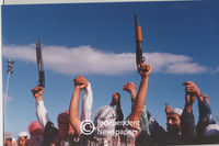 Pagad members stand holding hands with guns in the air, Cape Town