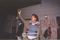 Pagad member holds his cell phone up in the air, Cape Town