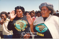 Two female Pan African Congress (PAC)  supporters salute the camera, Cape Town