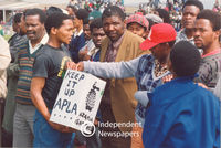 PAC supporter holds a APLA sign, Cape Town