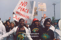 "PAC members with ""No Peace without Justice"" Signs, Cape Town"