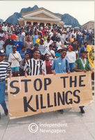 "PAC supporters with ""Stop the killings"" sign at UCT, Cape Town"