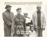 Soldier stands in front on onlookers who wait to see President Botha, Cape Town