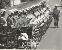 Soldiers stand next to their motorcycles as their commander inspects them, Cape Town