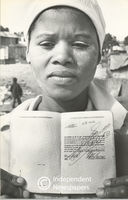 Woman shows her pass book, Cape Town