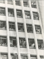 People at work watch the march from windows, Cape Town