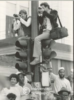 Men climb up onto traffic lights to take photos, Cape Town